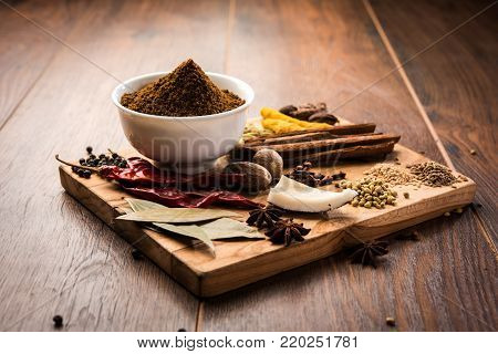 Colourful spices for Garam Masala. Food ingredients for garam masala, indian spice mix with Powder. Selective focus