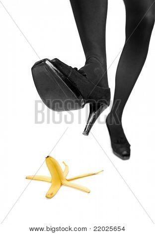 Woman about to step on a banana peel isoltaed on white background