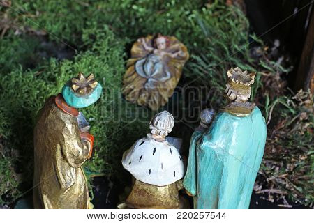 the three holy kings are bringing gifts to the new born child Jesus, rear view of the figurines, close-up