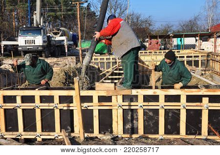 KYIV, UKRAINE - January  03, 2018: Foundation building. Pouring a concrete slab formwork along the foundation.