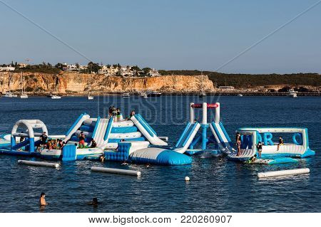 Portimao, Portugal, August 19, 2017: Navibordo Water Sports installation on the Portimao's Praia da Rocha beach