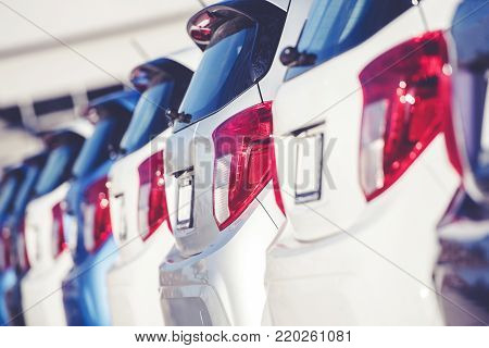 Car Dealer Business Concept. Row of Brand New Compact Cars on the Dealer Lot. Transportation Industry.