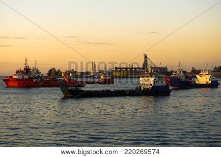 Labuan,Malaysia-Dec 26,2015:Offshore oil & gas support vessels in the ocean at twilight sunrise sky at Labuan,Malaysia.