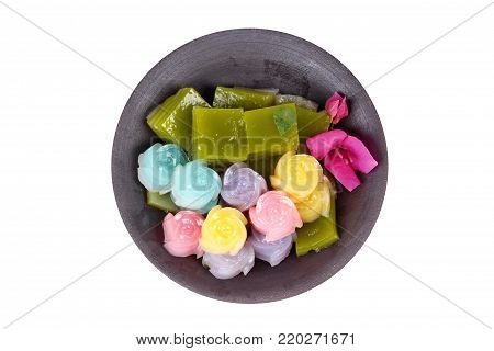 Isolated of Colorful of Thai steamed layer cake in cube and rose shape,call Khanom Chan in Thai,isolated on white background.  Have text space on left.