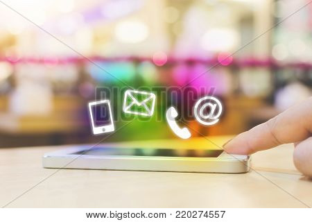 Woman hand pushing button smartphone, Business connection contact us and call center customer service concept, Icon mobile phone, email envelope, telephone and e-mail address
