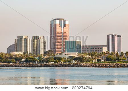 LONG BEACH, CALIFORNIA - SEPTEMBER 8, 2017: Downtown cityscape in the morning light with Long Beach Harbor in foreground.