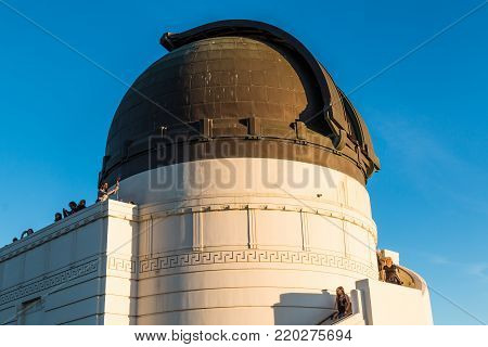 LOS ANGELES, CALIFORNIA - NOVEMBER 19, 2017:  People enjoy the view from atop Griffith Observatory, near the dome housing a Zeiss 12-inch refracting telescope and available for nightly public viewing