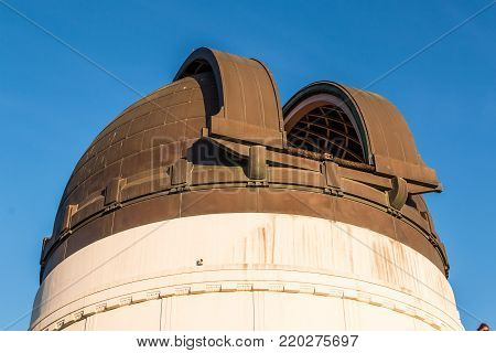 LOS ANGELES, CALIFORNIA - NOVEMBER 19, 2017:  The copper dome housing a Zeiss 12-inch refracting telescope which allows the public to view the evening skies at Griffith Observatory.