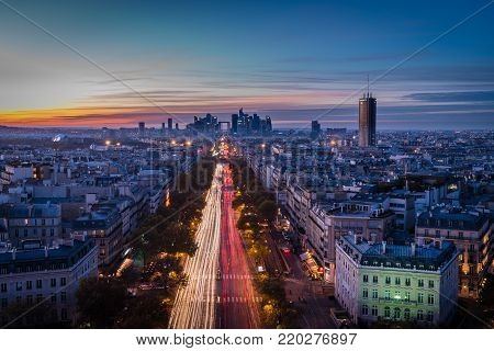 La Defense Arch And Business District In Paris Seen From The Arc De Triomphe At Sunset