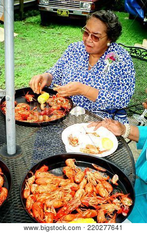 NEW ORLEANS, LA. JULY 18, 2006. CIRCA: African american senior women enjoying crayfish at the annual cajun bayou seafood festival in New Orleans.