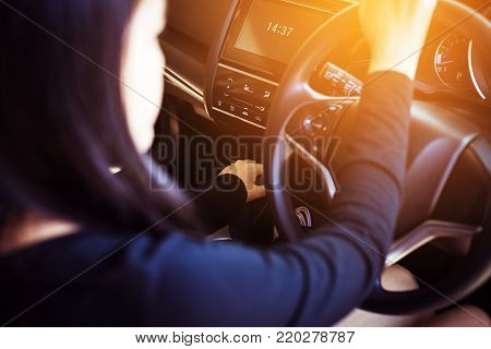 Hand woman on automatic gear shift,Close up
