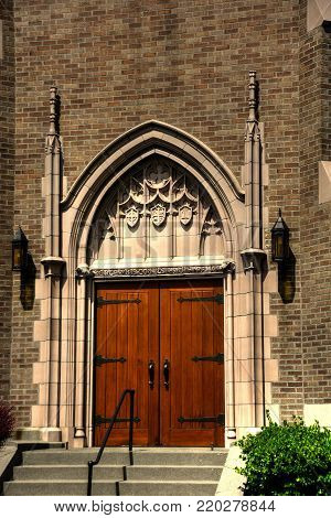 Front Door Detail - Gothic Church in Bellingham, WA with blue sky and wispy clouds