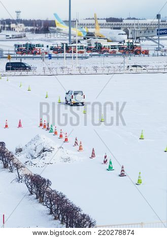 Hokkaido, Japan - 27 December 2017 - Car parks in parking lot full of snow at the Chitose International Airport in Hokkaido, Japan on December 27, 2017