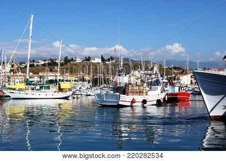 CALETA DE VELEZ, SPAIN - OCTOBER 27, 2008 - View of fishing boats and yachts in the harbour, Caleta de Velez, Malaga Province, Andalusia, Spain, Western Europe, October 27, 2008.