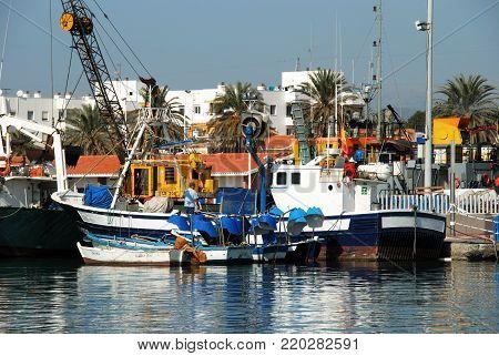 CALETA DE VELEZ, SPAIN - OCTOBER 27, 2008 - Fishing trawlers moored in the harbour, Caleta de Velez, Malaga Province, Andalusia, Spain, Western Europe, October 27, 2008.