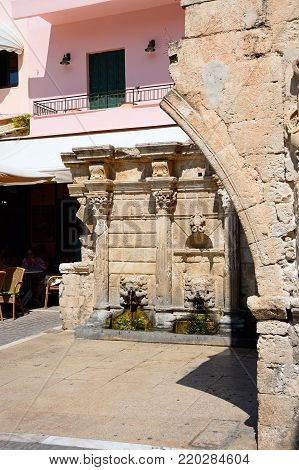 RETHYMNO, GREECE, SEPTEMBER 15, 2016 - View of the Venetian Rimondi fountain in Petychaki square, Rethymno, Crete, Greece, Europe, September 15, 2016.
