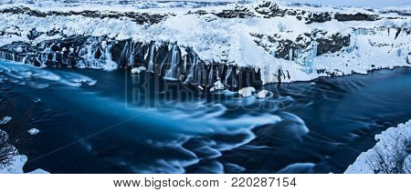 Hraunfossar waterfall in winter, long exposure. One of the most popular waterfall in Iceland, Europe.