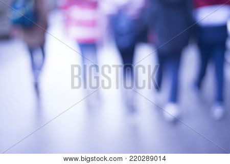 pedestrian on zebra in motion blur, Blur abstract people background, unrecognizable silhouettes of people walking on a street