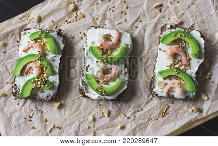 the sandwiches on grain bread with ricotta, shrimp and avocado