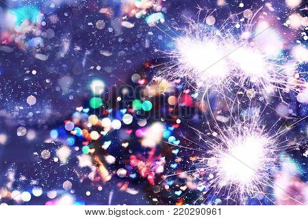 New Year Christmas. Abstract background, bokeh, Bengal lights sparkles closeup