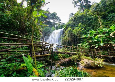 beautiful waterfall in northern Thailand, name Pha dok siew waterfall in Doi intanon national park with bamboo bridge.