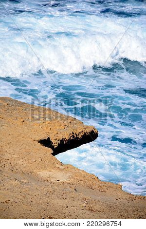 Rugged rocks overhanging the sea, Redoubt, Marsalforn, Gozo, Malta, Europe.