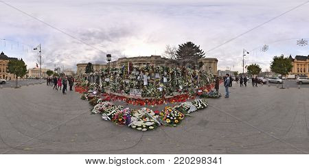 BUCHAREST, ROMANIA - DECEMBER 16, 2017: 360 Panorama of Piata Revolutiei with heaps of flowers, candles and leaflets put in front of the Royal Palace in rememberance of the deceased king, Michael I