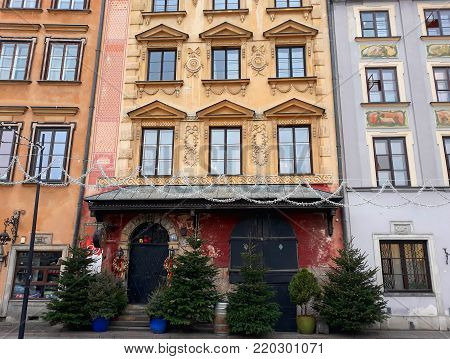Warsaw, Poland - 15 December 2017: Ancient colorful townhouses in Old town decorated for Christmas