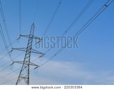 Electricity power supply pylon with a blue sky and clouds background