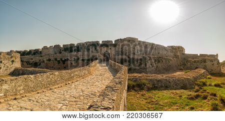 Methoni, Greece 9 August 2017. Panorama of the castle of Methoni against the sun.