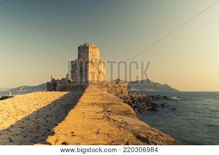 Methoni, Greece 9 August 2017. Methoni castle against the sunset.