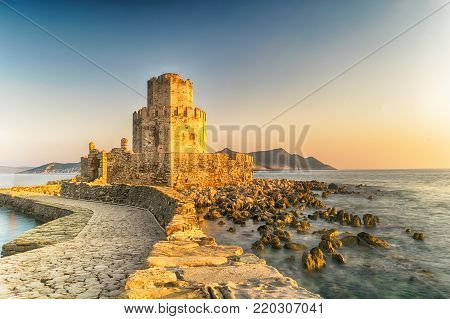 Methoni, Greece 9 August 2017. Castle of Methoni in Greece against a beautiful sunset.