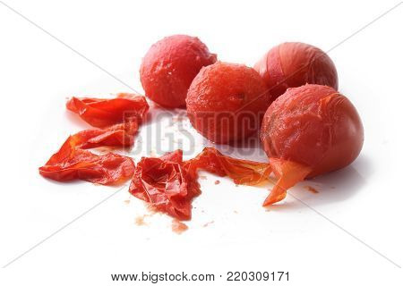 peeling tomatoes, cooking theme with peeled tomatoes and peel isolated on a white background, copy space, selected focus, narrow depth of field