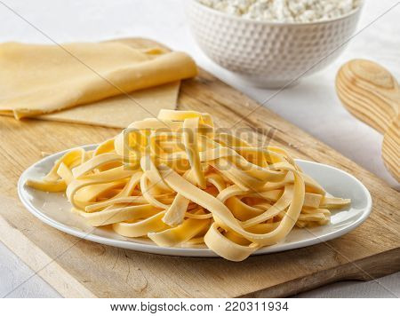 Fresh homemade tagliatelle Italian pasta with flour.