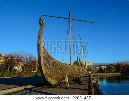 Vyborg, Russia - Oct 5, 2016. Drakkar (Viking wooden boat) on the waterfront in Vyborg, Russia. Vyborg is 174km northwest of St Petersburg, and just 30km from the Finnish border.