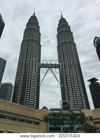 Kuala Lumpur, Malaysia - Nov 10, 2017. Petronas Twin Towers at sunny day in Kuala Lumpur, Malaysia. Petronas Twin Towers were the tallest buildings in the world from 1998 to 2004.