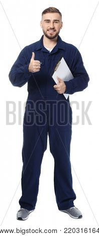 Handsome auto mechanic showing thumb-up gesture on white background