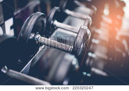 Black Steel Dumbbell Set. Close Up Of Dumbbells On Rack In Sport Fitness Center. Workout Training An