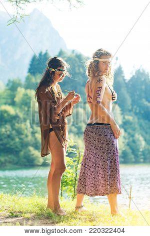 Pretty Free Hippie Girls. Body Painting - Vintage Effect Photo