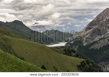 Beautiful summer scenery of the Dolomites and Lago di Fedaia. Italy.