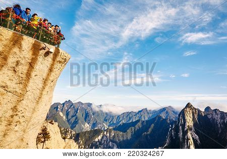 Mount Hua, Shaanxi Province, China - October 6, 2017: Tourists Admire Scenic View From Huashan Mount
