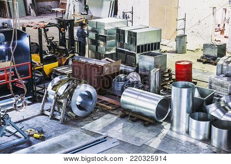 Interior of manufacturing metalworking factory warehouse with  modern equipment tools and machines. View from above