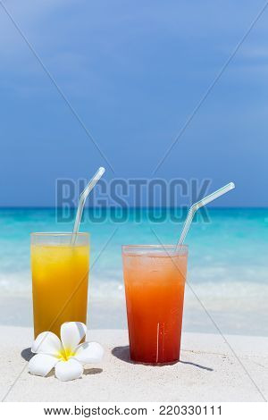 Cocktails In Glass On White Sandy Beach
