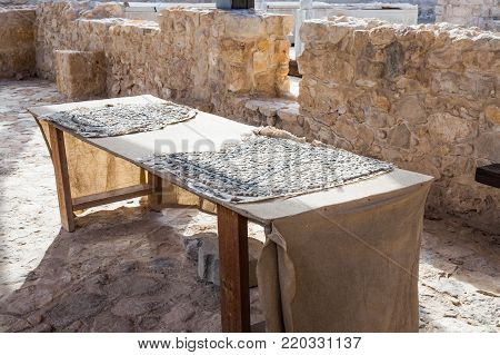 Near Kfar Adumim, Israel, November 25, 2017 : The table is restored with mosaic fragments in The Good Samaritan Museum Near Kfar Adumim in Israel