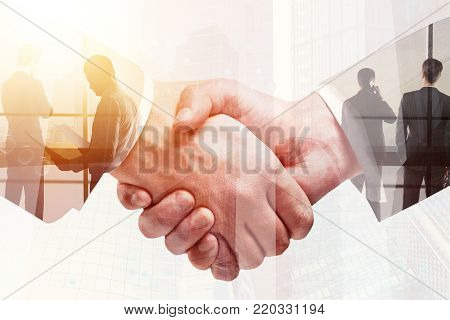 Side view of attractive businesswoman and young businessman holding document on abstract city background. Teamwork and success concept. Double exposure