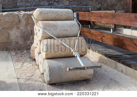 Near Kfar Adumim, Israel, November 25, 2017 : Rollers for compressing plaster on roofs and floors from the Hellenistic period in The Good Samaritan Museum Near Kfar Adumim in Israel