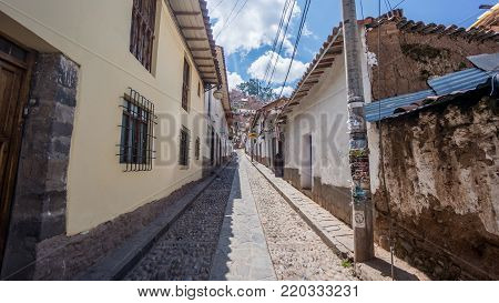 Cusco, Peru - September 2017: Narrow street in Cusco old town neighbourhood, Peru