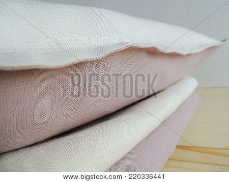 Natural linen handmade white pink pillow cover, pillowcase, cushion on linen sheet.