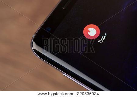 New york, USA - January 2, 2018: Tinder social media application icon on smartphone screen close-up. Tinder social media  app icon with copy space on screen