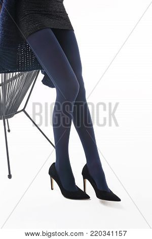 Tights. Beautiful and shapely legs of a woman in opaque tights.